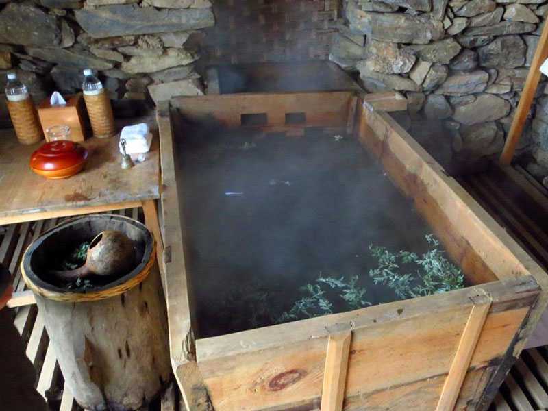 A traditional hot stone bath set ready for the traveler
