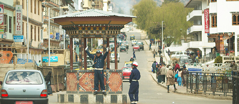 A traffic police directing vehicles in Thimphu